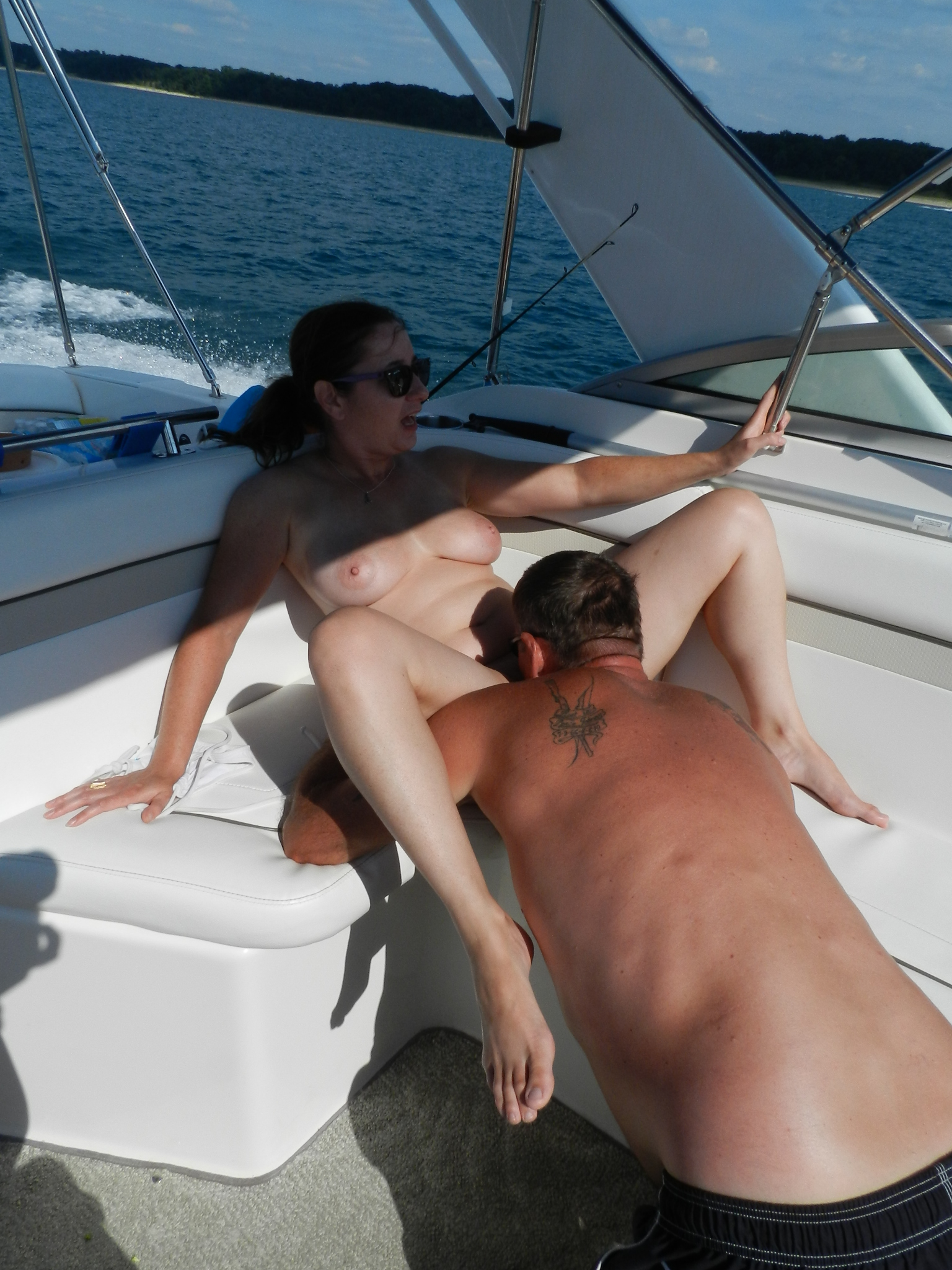 wife bent over boat