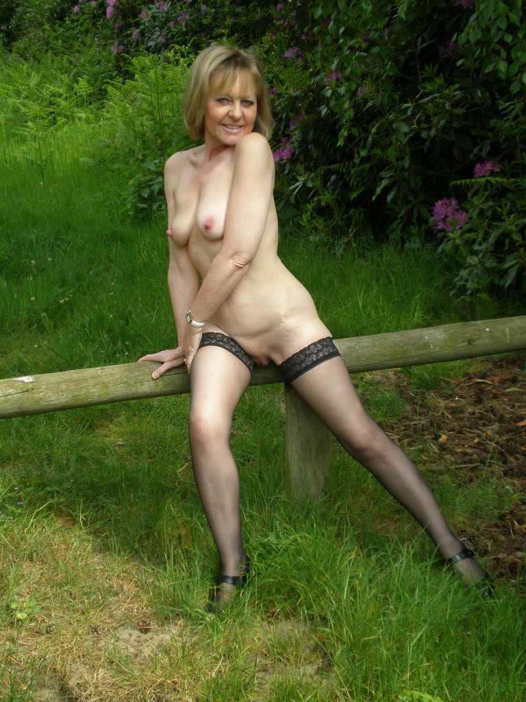 Randy blonde in black stockings stripteases on cam 9