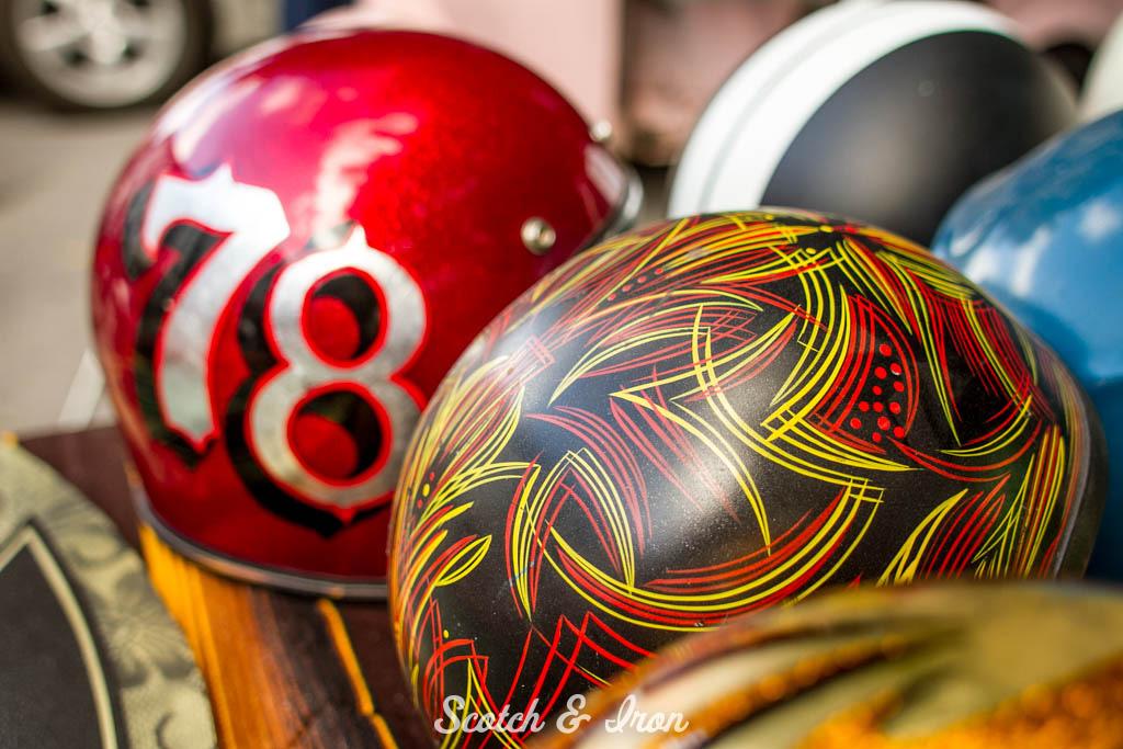 vintage old school motorcycle helmets hand striped