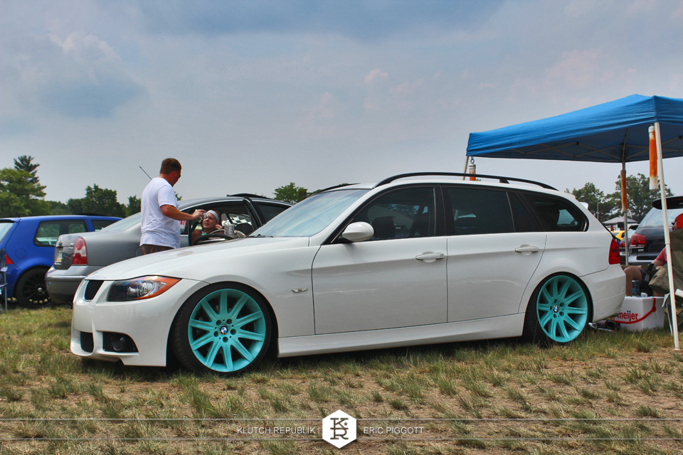 white bmw wagon on teal wheels