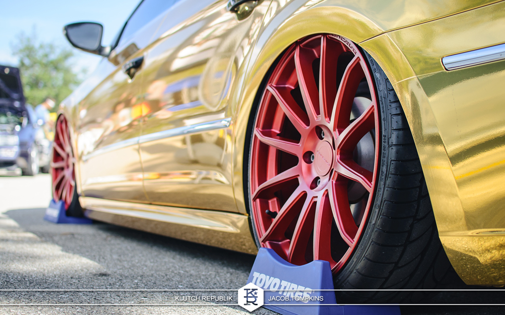 red concavo wheels on gold passat cc vw